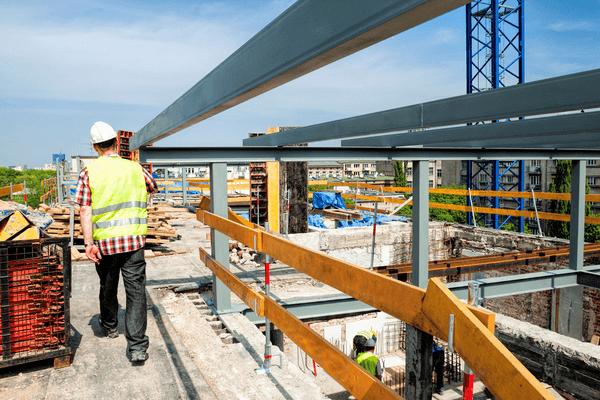 Worker walking through construction site