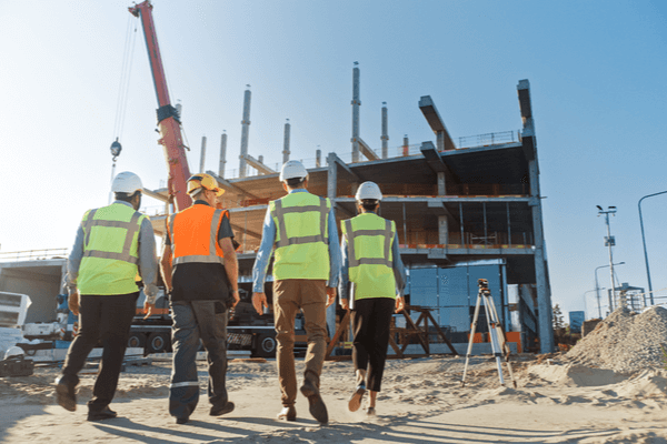 four construction workers at commercial construction site