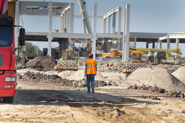 Construction worker walking through construction site